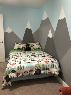 My son Kyler's room (via Keepittokatie) Mountains painted on the walls for a woodland themed bedroom for a toddler boy. Comforter is pillow fort by target