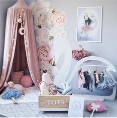 Little girls room with draping teepee tent, rose petal wall decals and soft plush textures