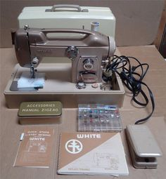 Vintage White Sewing Machine Zig-Zag 769 w/ hardcase & manual Made In Japan. Built-in decorative stitches. Has cool cut out handle made into top of machine. Beige and cream. 2/20/15 Ebay BIN $199 OR Best Offer