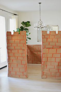 Pictures of how we made the castle from PVC pipes and craft paper.