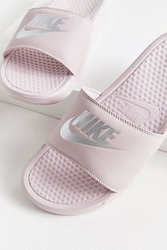 a8bece8e9 Nike Just Do It slides are equipped with massaging texture foot beds +  phylon cushion soles to give your feet some much needed post-workout TLC  added onto ...