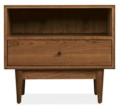 Mid-century details like solid wood turned and tapered legs and beveled edges lend an air of refinment to the Grove nightstand. Handcrafted by Pennsylvania woodworkers, Grove features an oil-and-wax finish that enhances the natural grain pattern of every panel of its solid wood construction.