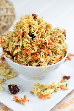 ½ small Savoy cabbage, finely shredded  1 carrot, grated  75g fresh coconut, grated  ¼ cup fresh parsley, chopped  1 green onion, finely chopped  ¼ cup dried cranberries  ¼ cup raw sunflower seeds  ¼ cup white wine vinegar  1 tbsp Dijon mustard  1 tbsp fresh ginger, grated  ½ tsp Sambal Oelek  ½ tsp salt  ¼ tsp black pepper