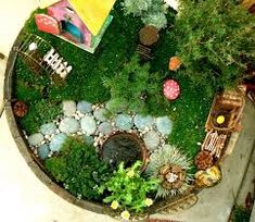 How to make a Fairy Garden from The Magic Onions. This magical, mini garden is lovely! This post offers wonderful instructions on how to make your own fairy garden. Mini Fairy Garden, Gnome Garden, Garden Kids, Fairy Pots, Fairy Gardening, Garden Crafts, Box Deco, Ideias Diy, Miniature Fairy Gardens