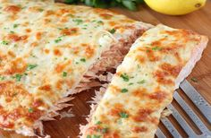 This Cheesy Baked Salmon is a whole salmon fillet baked in the oven under a melted and golden cheese crust. There is a layer of ultra thin slices of onion in between the fish and the cheese. Baked Salmon Recipes, Fish Recipes, Seafood Recipes, Cooking Recipes, Healthy Recipes, Healthy Food, Mashed Potato Cakes, Salmon Cakes, Salmon Food