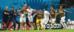 Moment #5 - Clint Dempsey scores for 2-1 lead United States' Clint Dempsey (8) runs to celebrate with his teammates after scoring his side's second goal during the group G World Cup soccer match between the USA and Portugal at the Arena da Amazonia in Manaus, Brazil, Sunday, June 22, 2014. (AP Photo/Paulo Duarte)