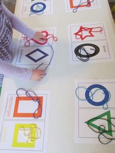 Learning about shapes. Using yarn to trace shapes, numbers and letters. Can also be a matching colors or pairing up pairs.