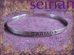 Cariad (Welsh for love) silver bangle made to commission by me and available from www.seirian.me £49