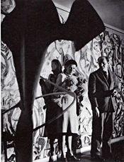 Peggy Guggenheim and Jackson Pollock with Pollock's Mural | 1943 | Guggenheim's New York City apartment