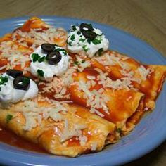 "Easy Mashed Potato and Roasted Vegetable Enchiladas | ""These are fantastic tasting and simple. My kids and husband loved them. I didn't dip the tortillas in the sauce, instead just dumped it over them before baking. You can change this up however you like, and with whatever veggies your kids like."""