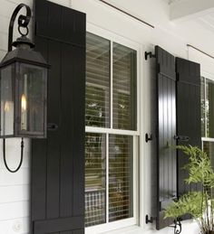 REAL shutters (ones that actually shut)!  That is the only way to go.  I would love to have these on my house someday.