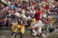 Quarterback Archie Manning of the New Orleans Saints sets up to pass against the Atlanta Falcons at FultonCounty Stadium on October 24 1971 in. Atlanta Falcons Team, Falcons Football, Manning Nfl, Nfl Uniforms, Milwaukee County, Nfl Photos, New Orleans Saints, Cleveland Browns, American Football
