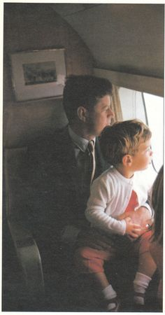 JFK, Jr. with his father aboard a helicopter between Hyannis Port and Otis Air Force Base, Massachusetts.