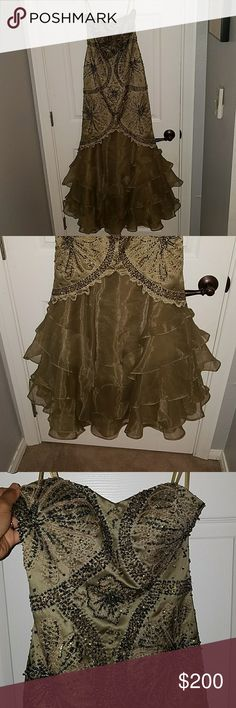 Olive green prom/evening gown This is a beautiful evening gown worn only one time and is just taking up space in my closet. Spring cleaning time means i need to get rid of the old gems to make room for new ones. This is a sz 6 but fits more like a 4-6. Feel free to ask any questions. Price is negotiable. Dresses Prom