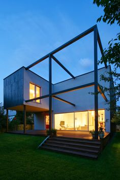 Black Cube House in Poland Tailored for a Modern Family Life