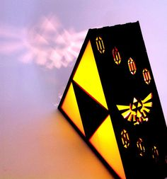 Zelda Triforce Lamp. $79.95, via Etsy......Paper, velum and a battery candle..could get the same effect :D