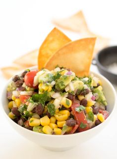 15 Minute Avocado Corn Black Bean Salsa. Perfect as an appetizer or snack! Serve at your next party with homemade tortilla chips!   chefsavvy.com #recipe #side #healthy #salsa