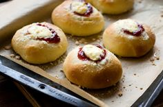 Strawberry cream cheese kolaches (koe-lah-chays) are Czech food pastries. Featured here with a sweet filling, but savory fillings are also common.