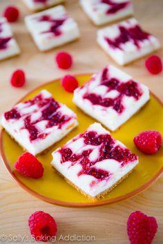 Skinny Raspberry Swirl Cheesecake Bars - these cheesecake bars taste like the real thing!  Get the recipe sallysbakingaddiction.com @Sally McWilliam M. [Sally's Baking Addiction]