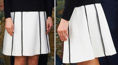 Queen Letizia premiered a white box-pleated skirt featuring a black contrast trim. 2016