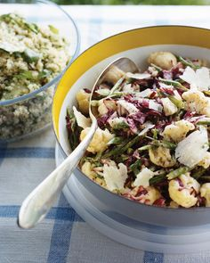 The bold dressing for this slaw is made by blending together anchovies, lemon zest and juice, Dijon mustard, roasted garlic, and olive oil. Sliced radicchio and blanched cauliflower and green beans are coated in the dressing, and the slaw is topped with Parmesan cheese before serving.