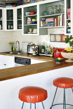 I've always liked a slightly cluttered kitchen counter. When I go to someone's house where there is nothing out I get a bit nervous. Where's the toaster and the tea bags and the cookbooks and the hairy ball of blue-tac that's got legos stuck in it? (Or is that just my house?)  Of course it's nice if it's artfully cluttered – no cereal boxes or loaves of Wonder bread on display, thank you very much. Everything's got to be decanted into nice jars or tins and anything unsightly put in a drawer…