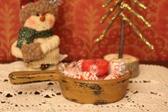 Holiday Home decor: Knitted Snowmen, distressed yellow wooden scoop, rustric twig trees.