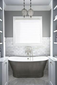 Superbe Grey Walls, Pearl Tile And Soaker Tub Make This Bathroom Elegant.