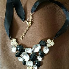 Gorgeous statement necklace, SALE! Black ribbon, adjustable...clear and black stones, goldtone metal. Spiegel Jewelry Necklaces