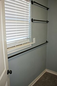 OhAmy: The industrial style rods in the laundry room are finally hung and ready to be dressed up! www.ohamyrepurposed.com