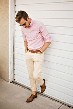 Shop this look on Lookastic: https://lookastic.com/men/looks/long-sleeve-shirt-chinos-oxford-shoes-belt-sunglasses-watch/11931 — Black Sunglasses — Pink Vertical Striped Long Sleeve Shirt — Brown Leather Belt — Dark Brown Leather Watch — Beige Chinos — Brown Leather Oxford Shoes