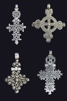 Africa | 4 pendant Christian Crosses from the Ethiopian Orthodox Tawahido Church | Silver | 19th - 20th century