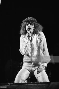 David Byron performing on stage, 75
