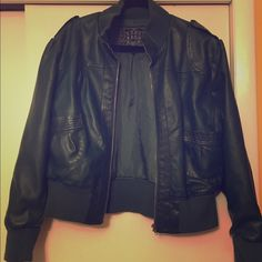 Dark green faux leather jacket Dark green faux leather jacket purchased from Macy's and it's in great condition by Last Kiss. The jacket has two snap enclosures on the shoulders and pockets on the sides. It's a size 3x but it fits more like a 1x. Jackets & Coats