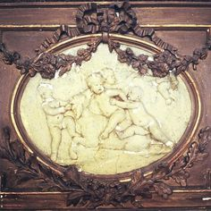 cherub bas relief with barbola roses and swags