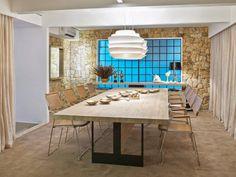 Com pedra, madeira, metal e tecido, o arquiteto Fred Adejar elaborou um espaço naturalmente harmônico.