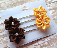These ADORABLE Hair/Bobby Pins are perfect for every girl or Woman! Yellow & Brown satin Flowers with middle rhinestones rested on Siler Bobby