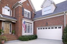 Amarr Short Panel garage door in True White with Stockton Windows. Available in Olympus, Heritage™, Lincoln, and Stratford® Collections. Visit www.amarr.com for more great styles.