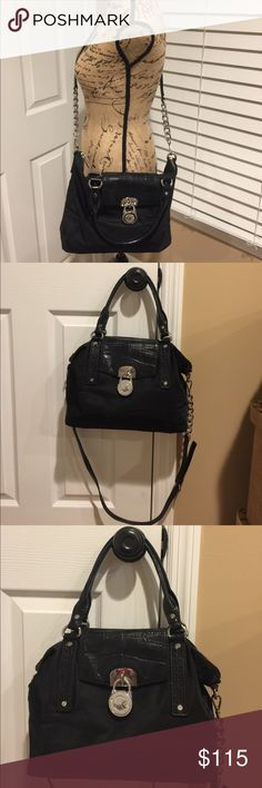 🌺MICHAEL KORS🌺Hamilton Slouchy Nylon Satchel 🌺🦋 MICHAEL KORS 🦋🌺 Hamilton Black Slouchy Nylon Satchel with silver-tone hardware. Great as a Crossbody Bag adjustable and removable strap.  There are a few marks on the front of the bag and on the inside.  This bag has a zipper on the inside and two pockets one for your cell phone and the another for your keys.  There is also two pockets on the outside one on each side.  Preloved in good condition. This a medium size bag very comfortable as…