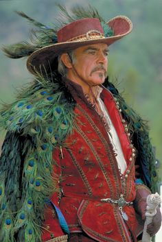 Okay, not a gown, or a woman. But look at that cloak. LOOK AT IT! Juan Sánchez Villa-Lobos Ramírez - the second best that Sean Connery has ever looked.
