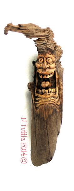 """""""OCD""""     7 inches tall and just over 6¼ inches wide.  All carved into one beautiful little piece of   driftwood from the southern Oregon coast.  This obsessed maniac is in hot pursuit of the   micro-knot growing from the end of his own head!  Signed and dated:   N. Tuttle 1/3/15"""