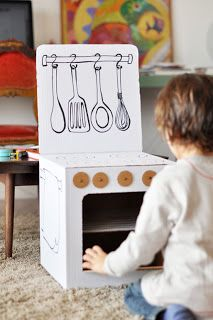 Craft a cardboard kitchen for your little cook. #DIY