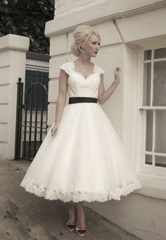 50's style wedding dress trimmed in lace. @Carmen Yee Yee Gonzalez