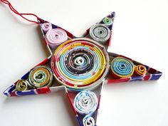 This beautiful star ornament is made from magazines.