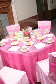 Hot Pink Table Linen With Light Pink Chair Covers. Www.amynixon.com