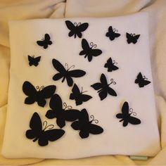 Cushion Cover - Black felt butterflies on white felt background.