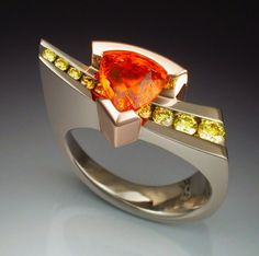 White gold ring with Spessartite Garnet and Diamonds