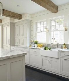 Current kitchen inspiration for a new project!  -- also some great @etsy deals on Beckiowens.com. White kitchen, rustic exposed beams, black floor.