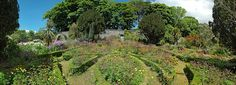 A panoramic view of some of the flower beds in Jura House Gardens on Islay's neighbour the Isle of Jura. The garden is a walled garden, providing protection against the harsh climate and allowing f...