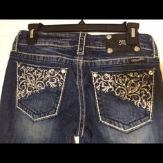 "Miss Me brand jeans. Straight leg. Miss Me jeans! Elaborate pocket embroidery with jewels. Size 28; stretch. Only wore them once! An old boss talked me into buying them and they are cute but not my style. 33"" inseam! Miss Me Jeans Straight Leg"